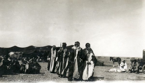 A tribal gathering in the desert, with horses, somewhere in Iraq
