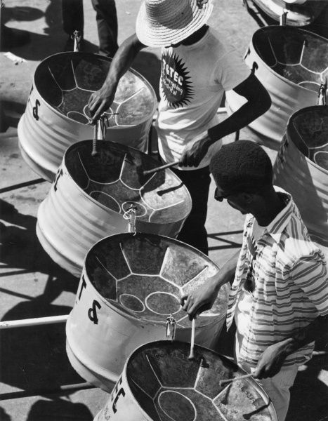 An oil drum band playing festive music at the annual Port of Spain Carnival, Trinidad, West Indies. Date: 1968