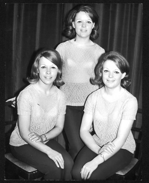 18-year-old teenage sisters, in matching machine-crocheted tops and slacks. Date: 1960s