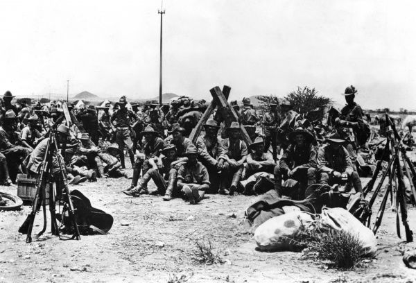 South African troops halted on a march and resting with their kit during the First World War, probably near the frontier with German South West Africa (now Namibia). Date: circa 1915