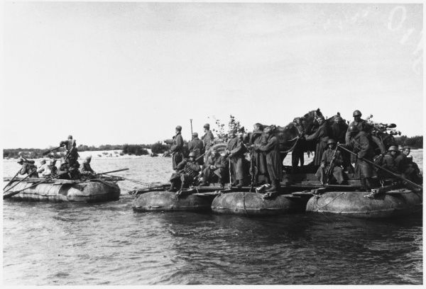 Soviet support troops cross the Volga by raft