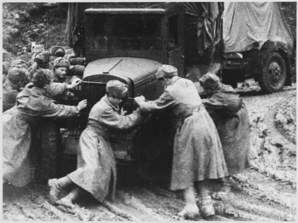Soviet troops try to move their truck trapped in the mud in the Ukraine