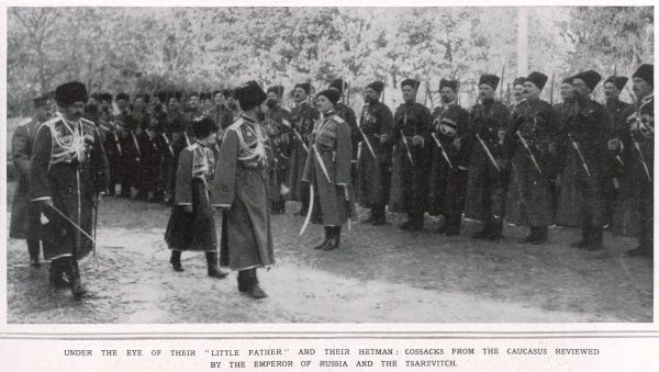 NICOLAS II OF RUSSIA Tsar Nicolas II and his son Alexei, the Tsarevich inspecting Cossack troops of the Caucasus during World War One