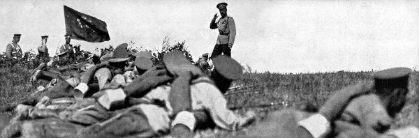 Photograph showing Tsar Nicholas II saluting troops during army manouevres