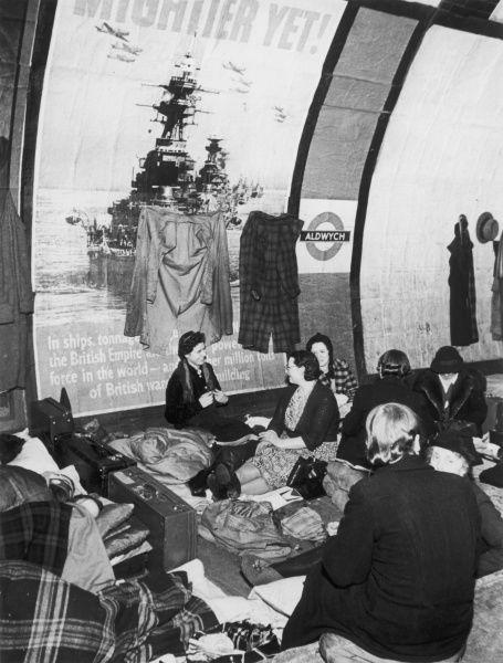 A group of ladies chat on the platform at Aldwych underground station, sheltering from the danger of German bombs