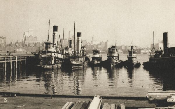 Tugs and Brooklyn from Lower Manhattan, New York, America