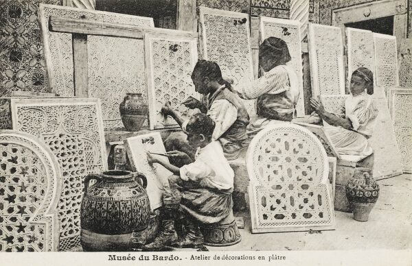 The carving of fantastically decorative plaster screens in a Tunisian workshop