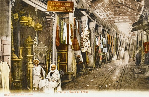 The Souk el Trouk at Tunis, Tunisia, which appears to be selling everything from lamps to patterned cloth and silks