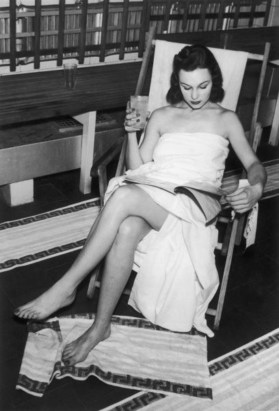 A young woman in a towel sits on a deckchair in a Turkish bath at Hotel Australia, Sydney. Turkish baths give that '100 per cent feeling', stimulating the circulation and complexion