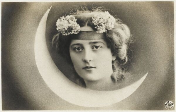 Turkish beauty with flowers in her hair, merged into a backdrop of a misty crescent moon