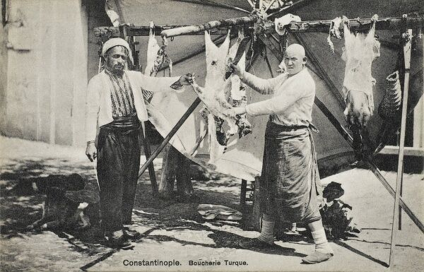 A Turkish butcher skinning a sheep in Constantinople