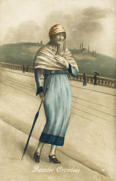 A Young Turkish girl standing on a bridge over the Golden Horn