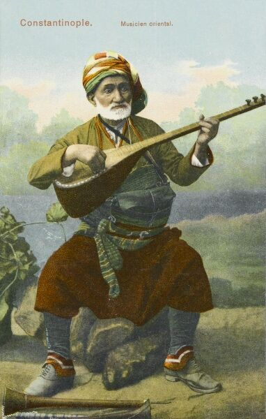 Turkish musician playing traditional stringed instrument