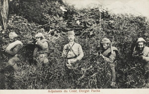 Turkish Ottoman Officer (Commandant Dergut Pasha) with his band of local militia emerge menacingly from the undergrowth - Albania