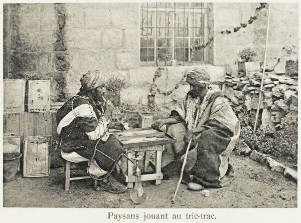 Two Turkish peasants playing Backgammon at an outdoor coffee house
