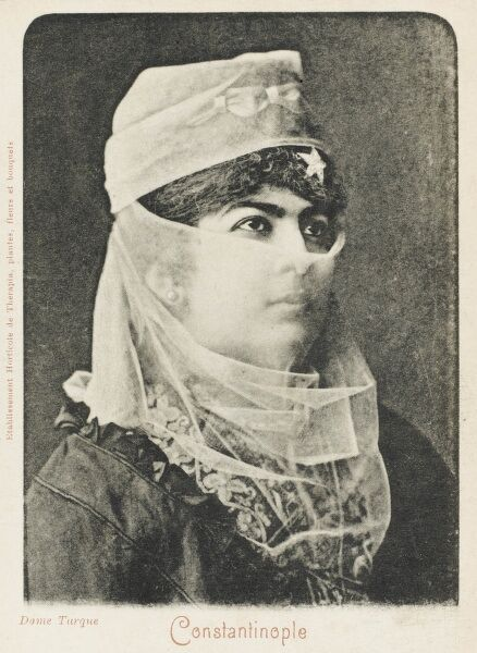 Veiled turkish Woman from Constantinople, Turkey with a star in her hair and her scarf/veil covereing a bow on top of her head
