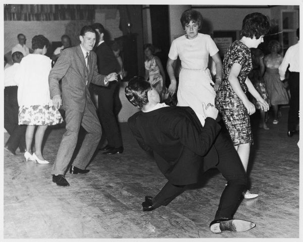 Young people do 'The Twist'; lads in suits try to impress the girls by athletic dancing, but to no avail