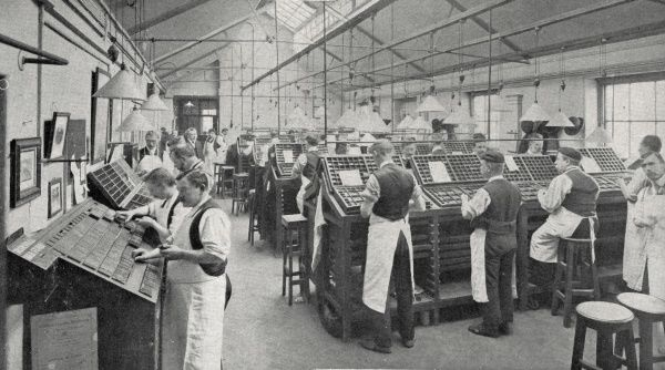 A roomful of male compositors in London, typesetting the pages of the Morning Post newspaper by hand