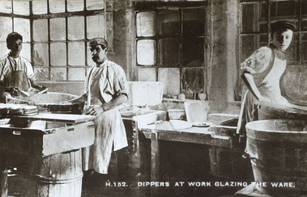 Dippers at work, glazing the ware, Date: circa 1910s