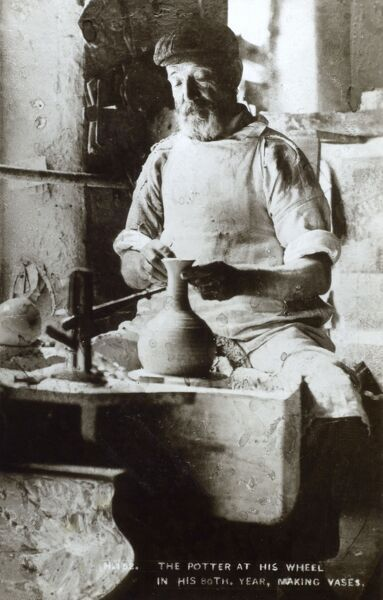 Potter at his wheel (in his 80th year!) making vases Date: circa 1910s