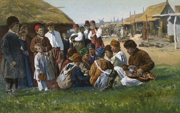 Ukrainian Villagers - listening to the music of a Hurdy Gurdy player Date: circa 1910s