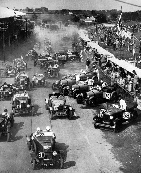 Photograph of the start of the Ulster T.T. Race, one of the greatest road-races of the motoring year, showing the lighter cars off to a frenzied start in August 1929