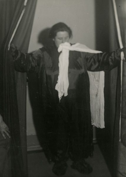 "Undated photograph showing ""ectoplasm"" forming from the Scottish medium Helen Duncan's mouth down her front and over shoulder. HPG/1/4/2 (v)"