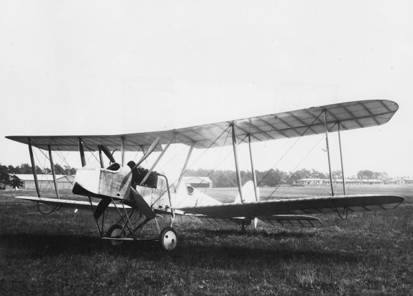 An unidentified two-seater biplane on an airfield during the First World War. Date: 1914-1918