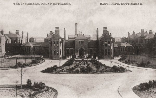 The front of the Nottingham Union Infirmary at Bagthorpe with staff standing outside. Designed by Arthur Marshall, the infirmary and its accompanying workhouse were opened in 1903. The site later became Nottingham City Hospital