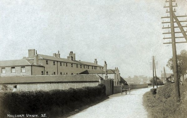 Hailsham Union workhouse was built in 1835-6 on what became Union Road (now Hawks Road) at Upper Horsebridge, Sussex. A horse and cart drive past the entrance