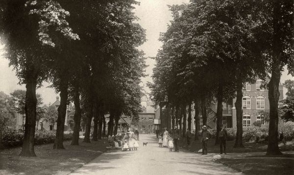 Entrance drive at Kingston Union workhouse with inmates, staff and children. The workhouse, designed by William Mason, was erected in 1837-9 on Coombe Road in Kingston upon Thames, Surrey. It later became part of Kingston Hospital