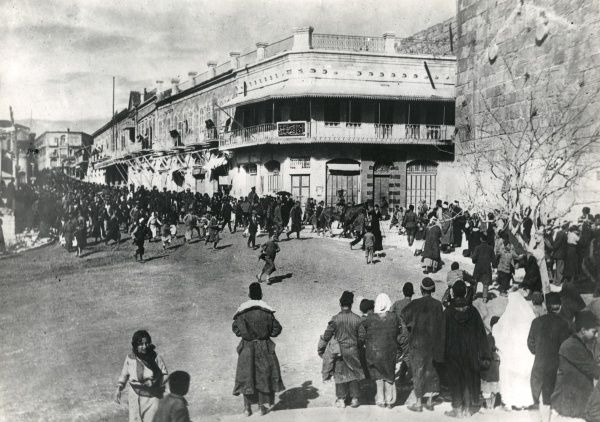 Street scene during the unofficial surrender of Jerusalem, First World War, two days before General Allenby's official entry. Date: 9 December 1917