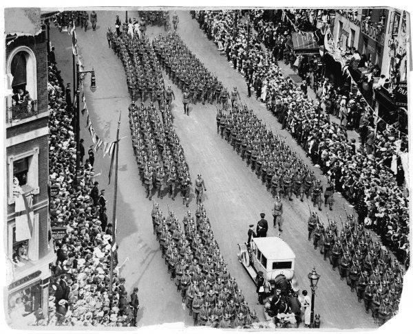 Troops from the United States march past Victoria Station, London