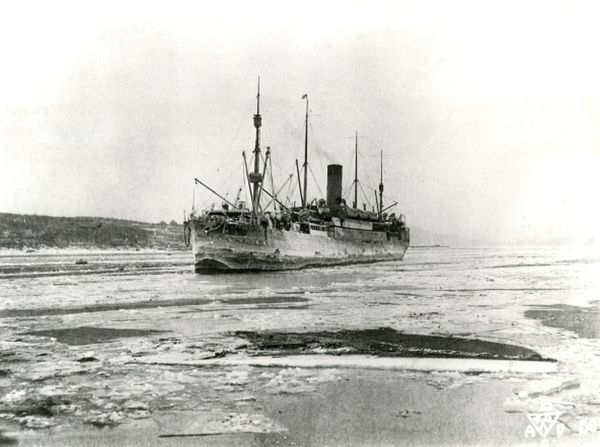 The US Army Transport ship Logan arriving in Vladivostok Harbour during the western intervention in the Russian Civil War. Date: circa 1918-1919