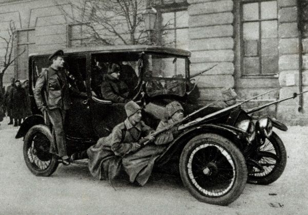 The photograph shows a Revolutionary car with soldiers on the footboard ready for action