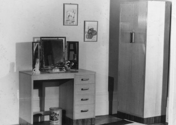 A matching Utility suite of bedroom furniture - a modern dressing table and wardrobe. Date: 1940s
