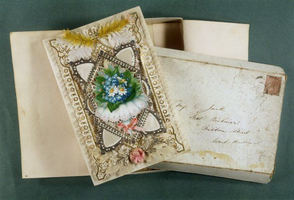 A Victorian card with its original packing - the expensive, elaborate ones were so fragile, they were delivered in boxes