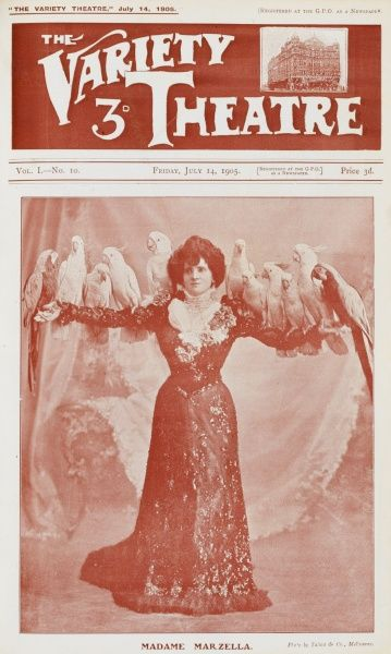 Music Hall star, Madame Marzella (doing a fine impression of a parrot stand) with her birds perched upon her outstretched arms