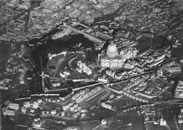 An aerial photograph showing St. Peter's Cathedral, the Vatican Palace and its gardens and the railway which leads through a gate of the wall into Vatican's city, Rome