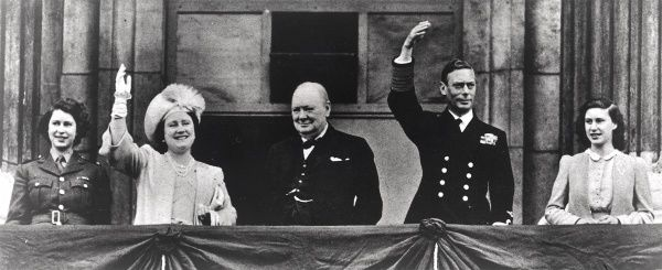 Winston Churchill and members of the Royal family waving to the crowds at Buckingham Palace on Victory in Europe Day