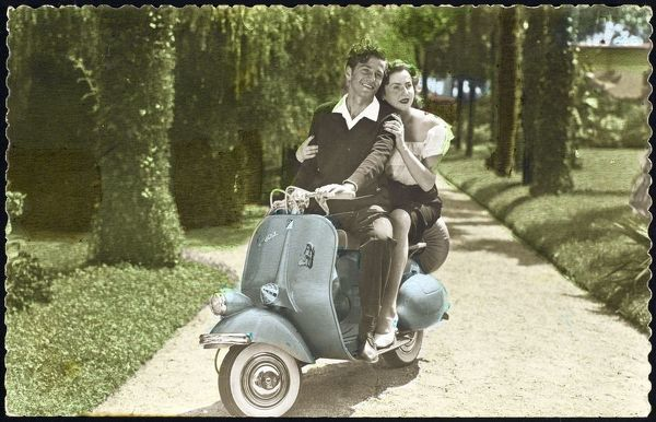 Couple on a VESPA - the machine whose glamorous image is one of the popular icons of the decade, a symbol of freedom and youth