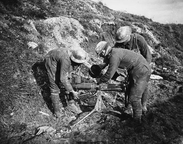 Soldiers filling the water jacket on a Vickers Machine Gun on the Western Front in Belgium during World War I in 1917