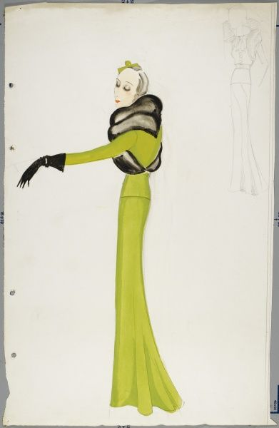 A design by Victor Stiebel (1907-1976) for an elegant green suit with fitted jacket, long bias cut skirt and fur stole