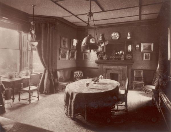 A Victorian dining room with electric light