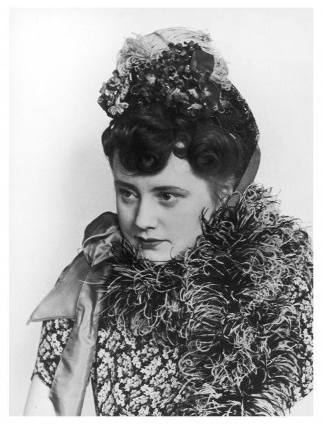 A Victorian style hat, worn with a boa, made poplular again in the 1940s, when so many period dramas were being made into popular films