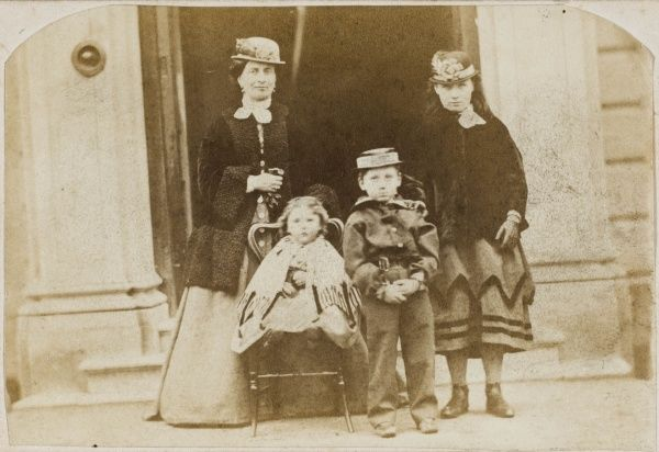 A Victorian mother and three children. They are Mrs Polhill-Turner (nee Emily Frances Barron, d 1913)), wife of Frederick Charles Polhill-Turner (1826-1881), with Alice (Alice Kate Frances, 1856-1931), Arthur (Arthur Twistleton, 1862-1935) and Beatrice