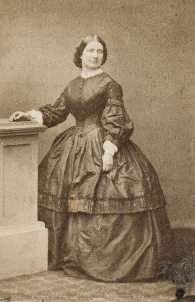 An upper class Victorian woman, probably a member of the Polhill-Turner family of Howbury Hall, Renhold, Bedfordshire. Seen here in a studio photograph, wearing a dark crinoline dress