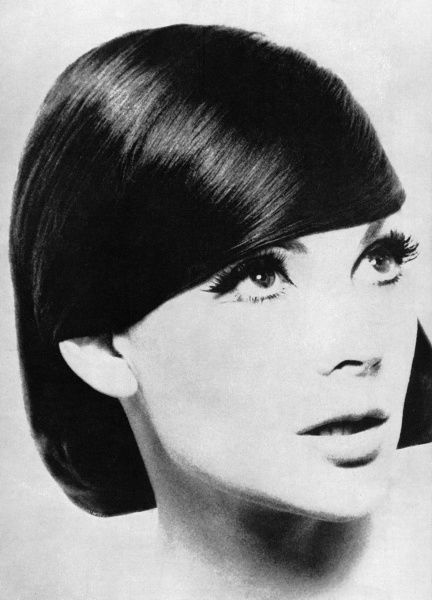 A smooth, sleek hairstyle by quintessential sixties hairdresser, Vidal Sassoon. Date: 1962