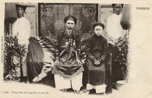 The Governor of the Province of Lang-Son in Northern Vietnam (Tonkin) with his son and servants/attendants behind