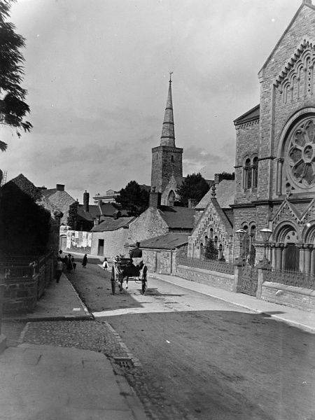 A view down Barn Street in Haverfordwest, Pembrokeshire, Dyfed, South Wales. A horse and cart makes its way past various chapels on the right hand side